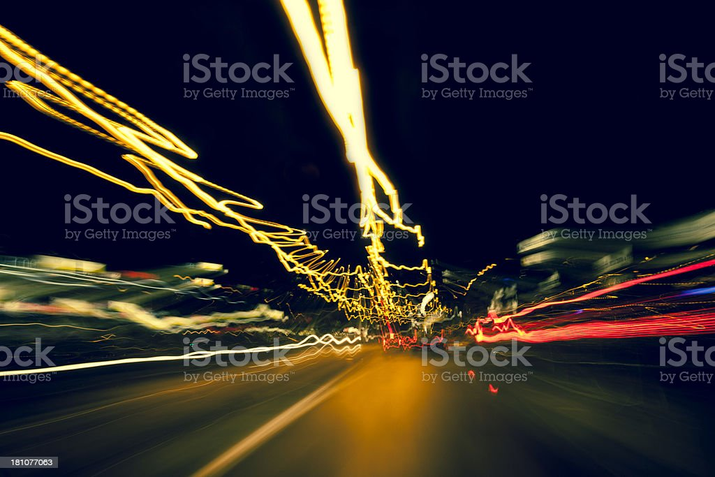 Highway driving at night with long exposure light trails royalty-free stock photo