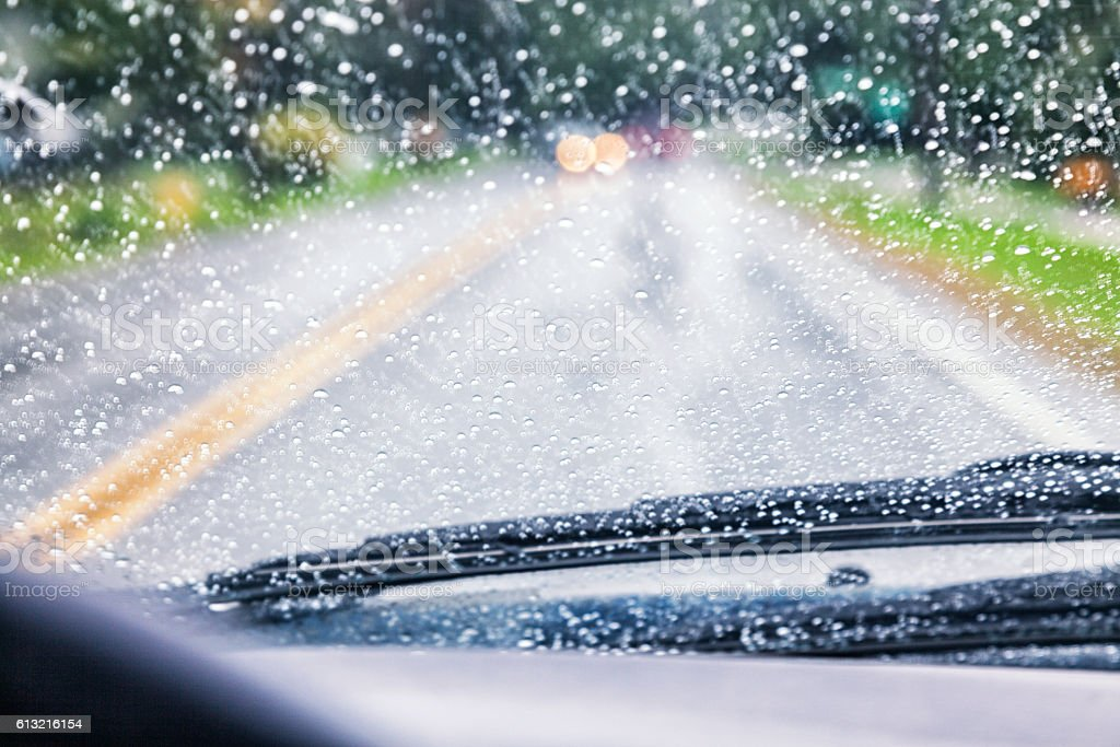 Highway Driving POV Through Spattered Car Windshield During Rain Storm stock photo