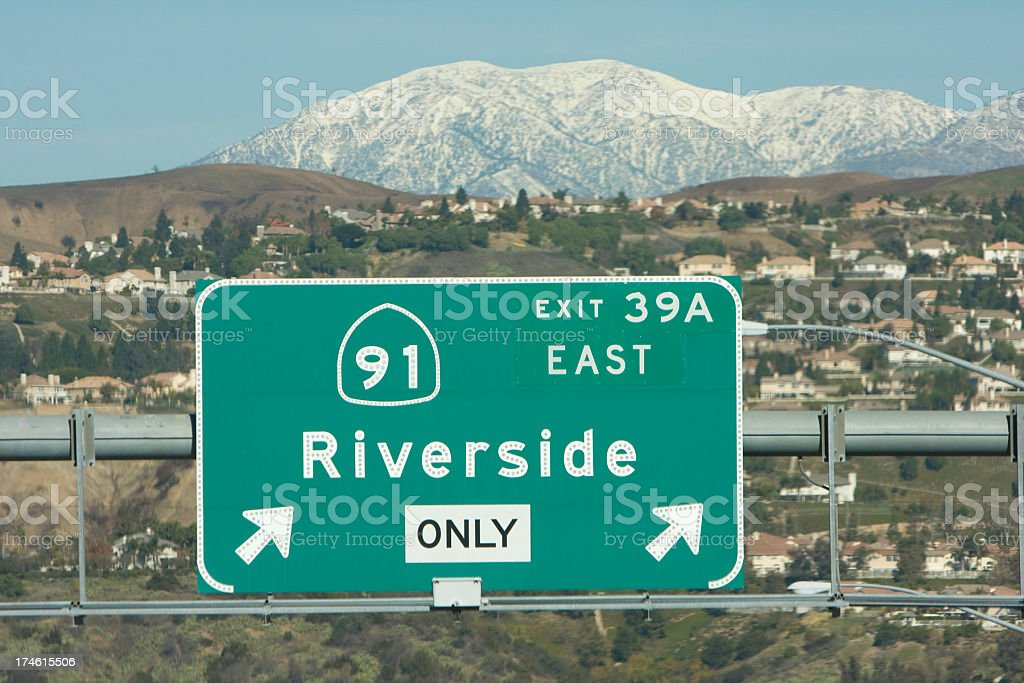 Highway exit sign with mountains behind stock photo
