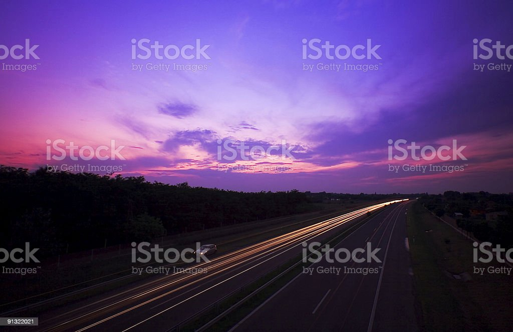 highway in sunset royalty-free stock photo