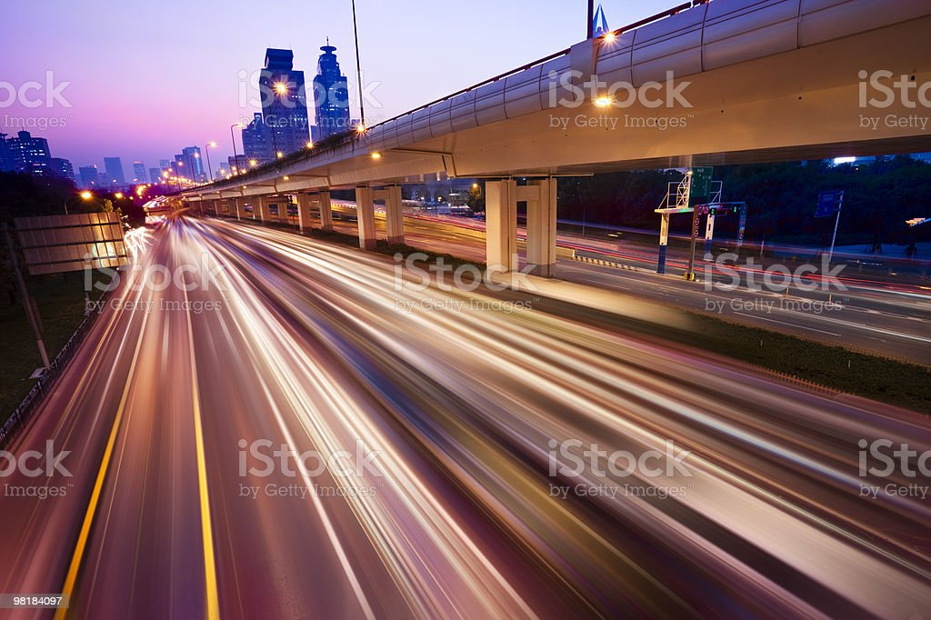 Highway in the evening shot on slow shutter speed royalty-free stock photo