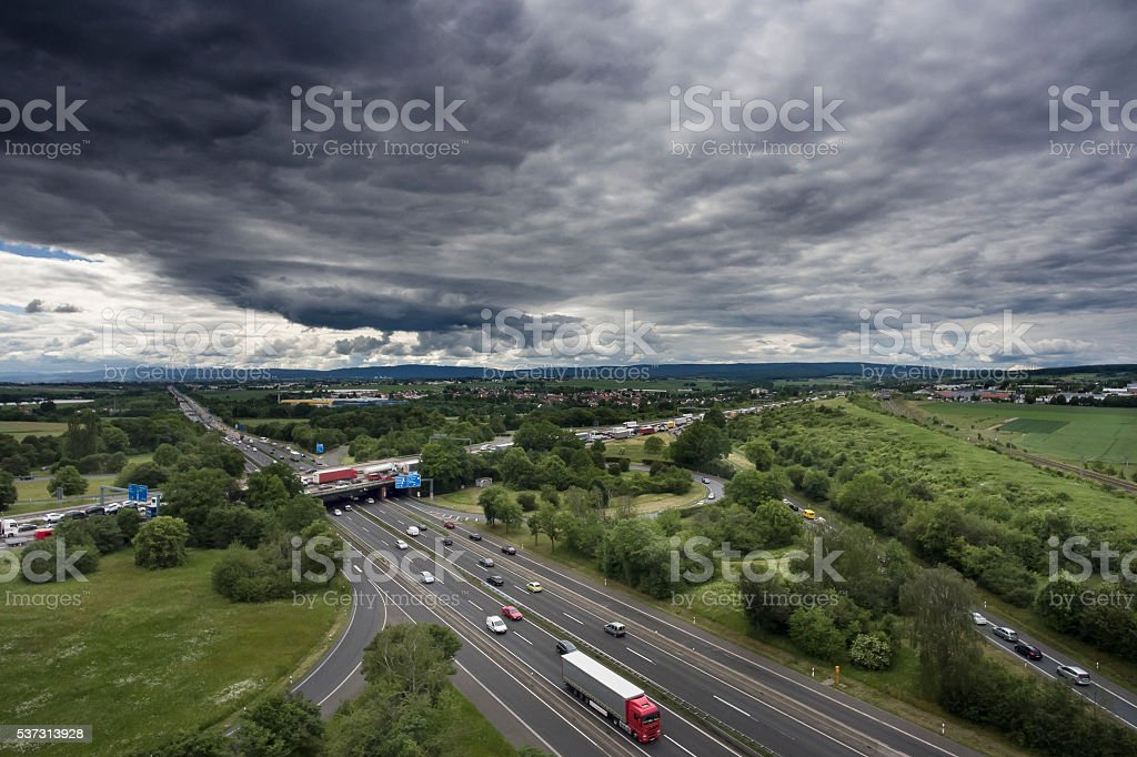 Highway interchange, cloudscape and thunderstorm stock photo