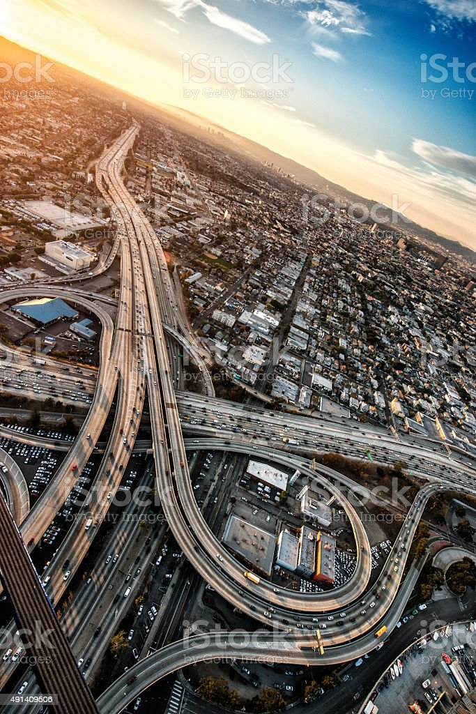 Highway interchanges at sunset stock photo