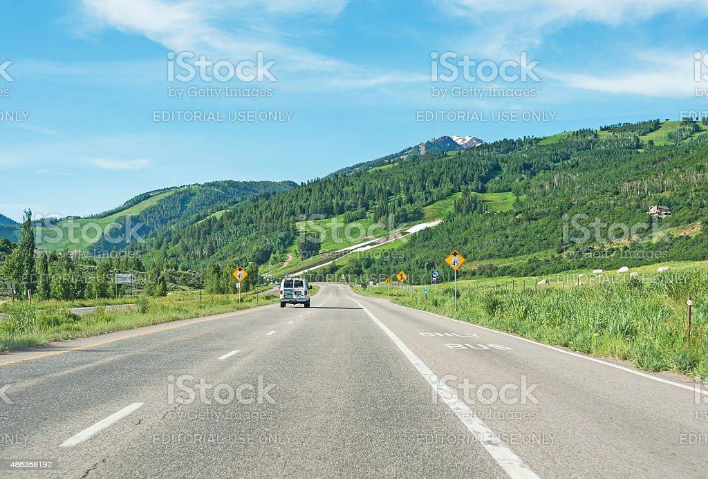 Highway into Aspen Colorado stock photo
