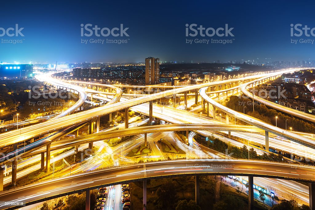 highway junction from above at night stock photo
