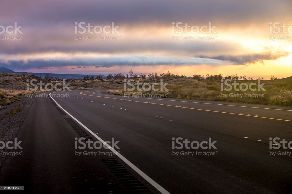 Highway leading into a Sunset Storm stock photo