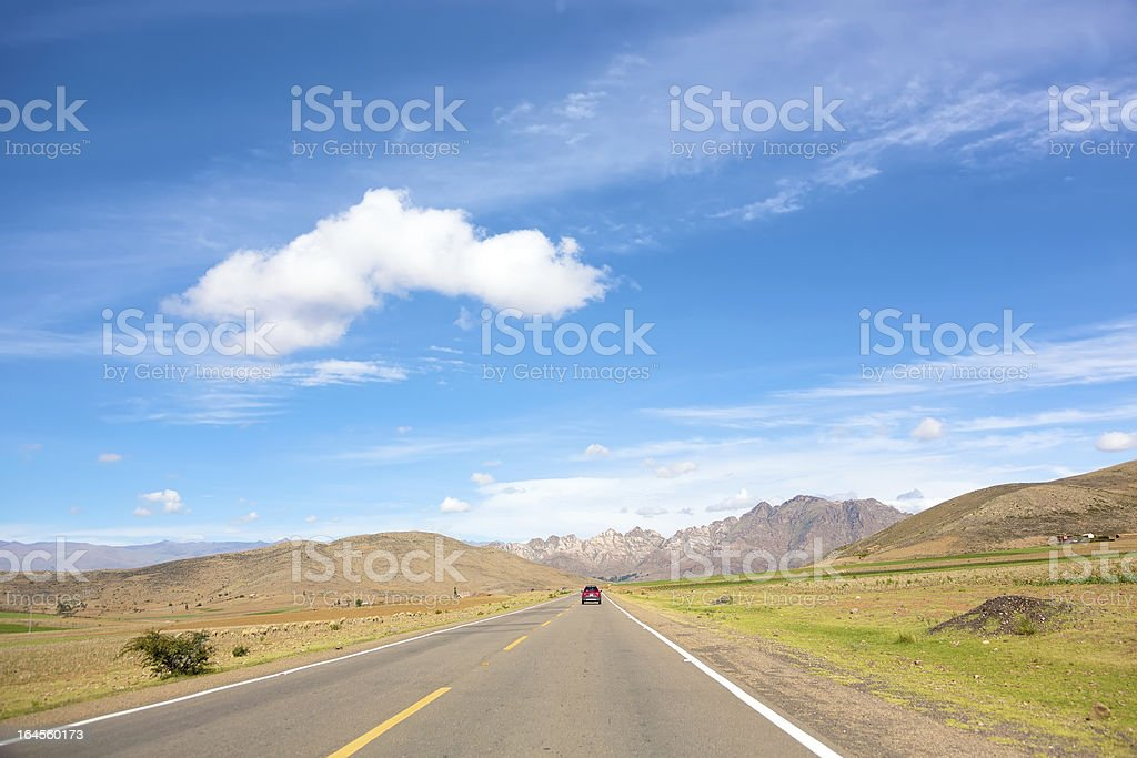 Highway leading to mountains royalty-free stock photo