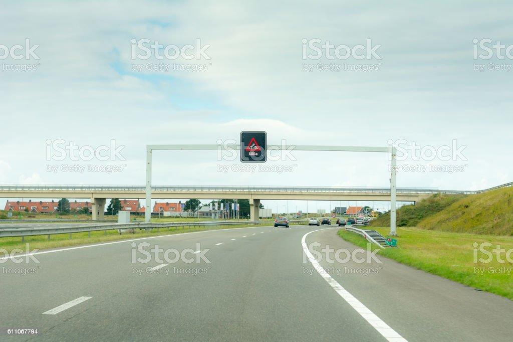 Highway nearing an opening bridge stock photo