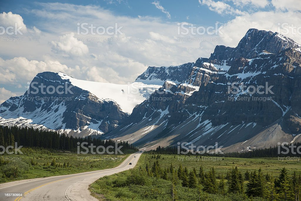 Highway passing below mountains royalty-free stock photo