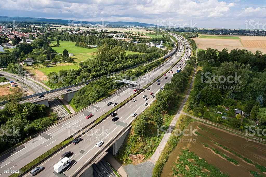 Highway, passing cars and traffic jam. Aerial view stock photo