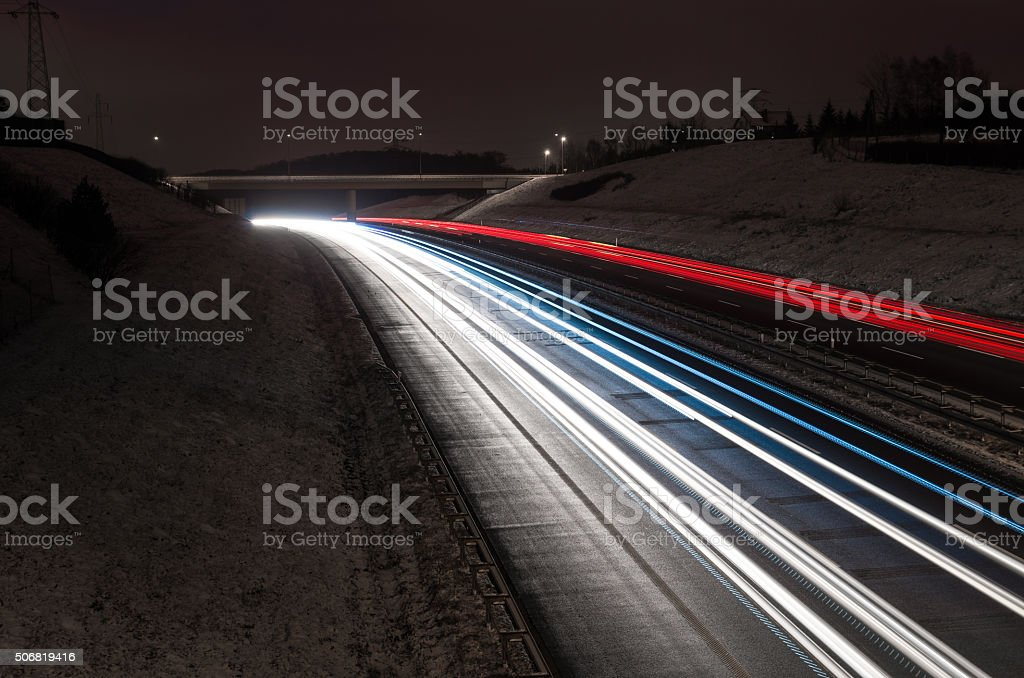 highway red and white car light trails stock photo
