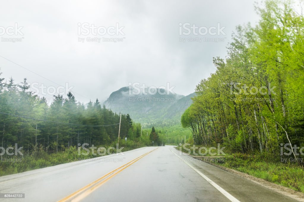 Highway road in stormy misty and foggy weather in mountain Charlevoix region of Quebec, Canada stock photo