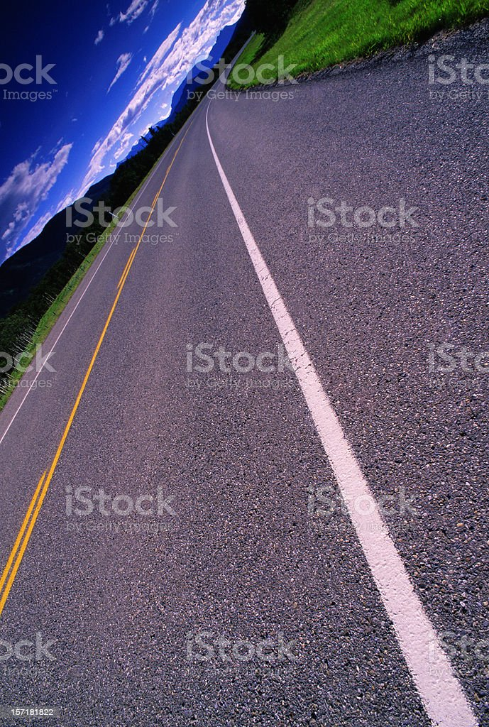 Highway Road towards Mountains, Tilted royalty-free stock photo