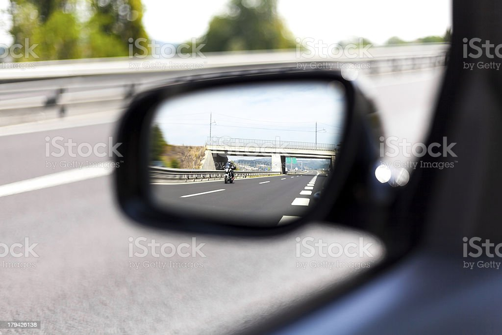 Highway side view mirror reflection I royalty-free stock photo