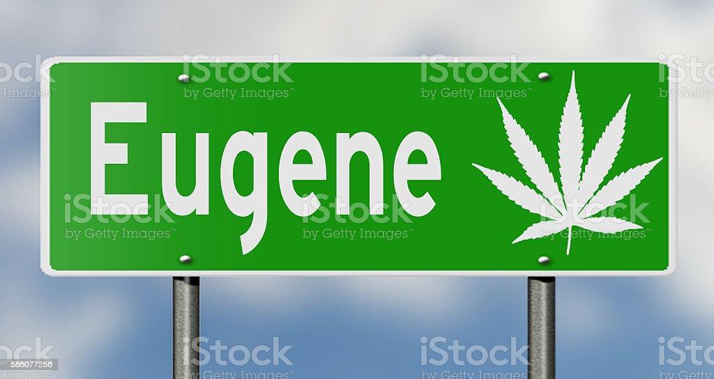 Highway sign for Eugene with marijuana leaf stock photo
