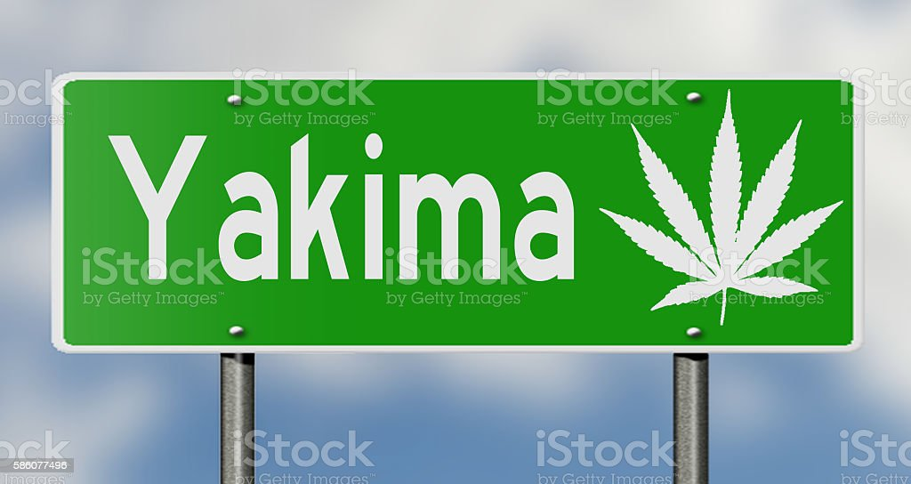 Highway sign for Yakima with marijuana leaf stock photo