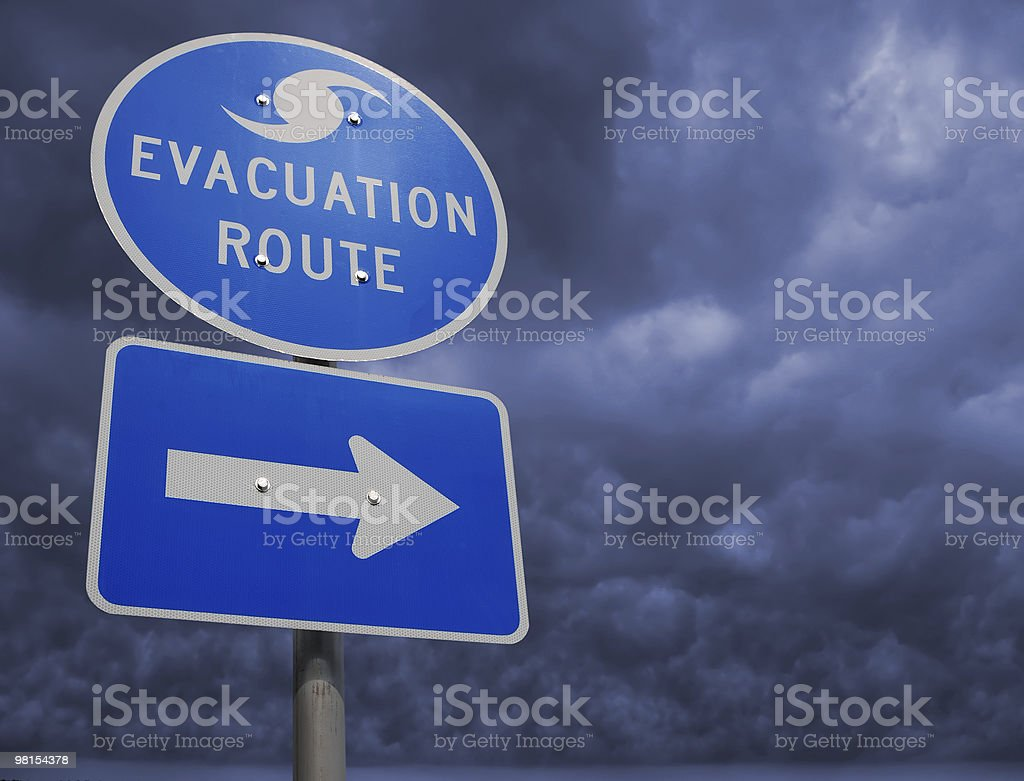 Highway sign pointing to a hurricane evacuation route stock photo
