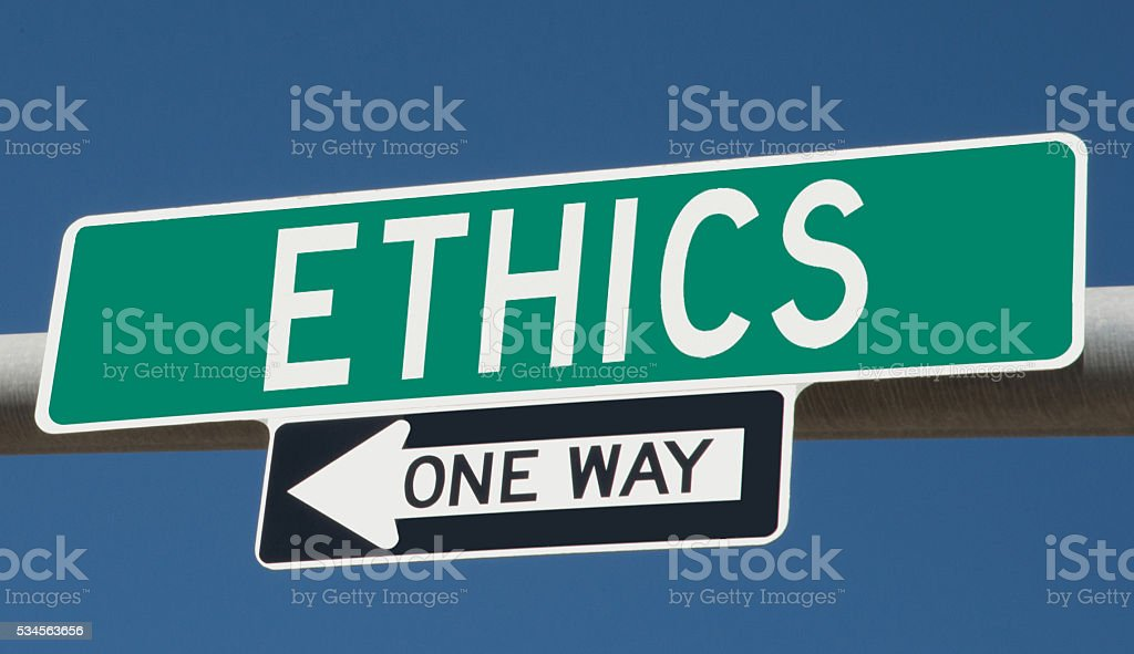 Highway sign with 'ethics' and 'one way' stock photo