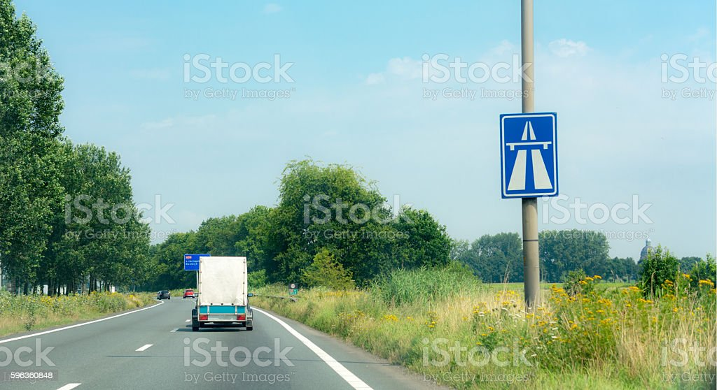 Highway sign with Trailer behind car on highway stock photo