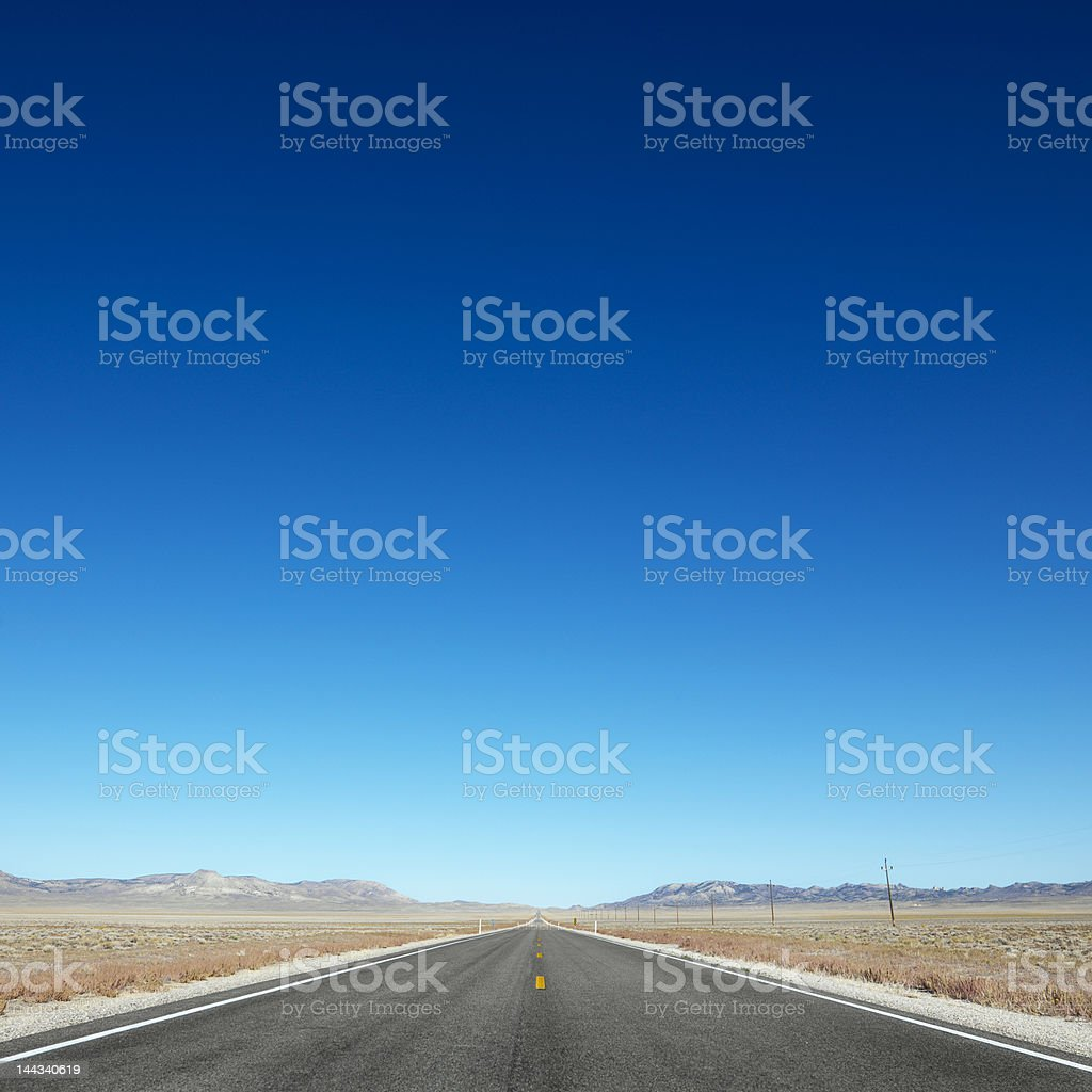 Highway stretching towards horizon. stock photo