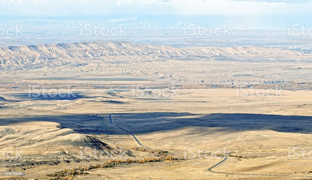 Highway through Big Horn Basin in northern Wyoming royalty-free stock photo