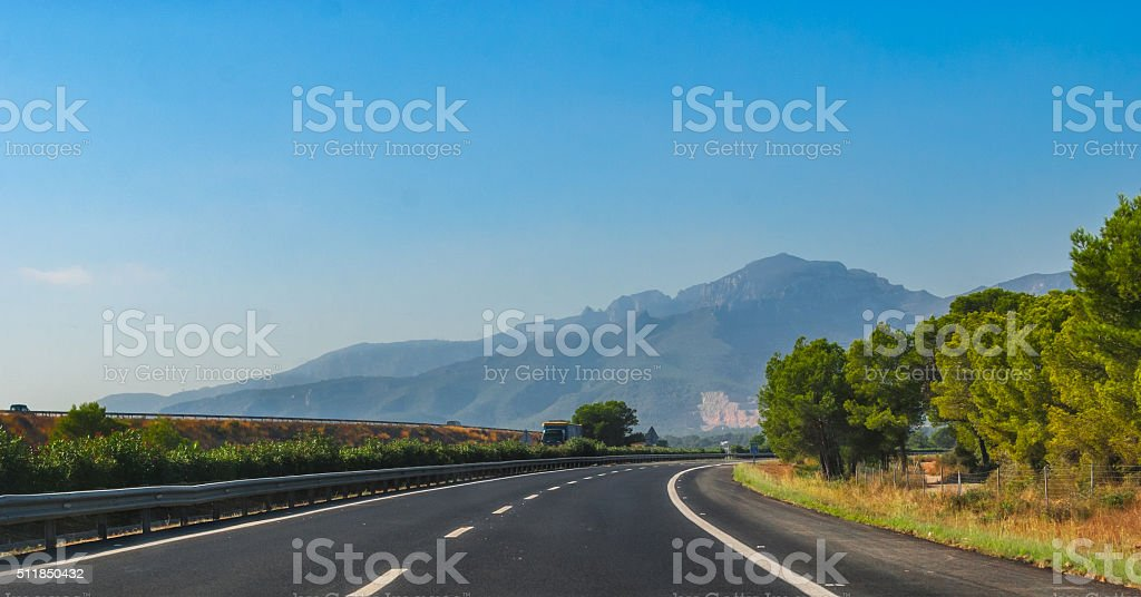Highway through coastal Foothills and mountains of Spain. stock photo