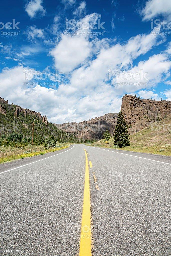 Highway Through Rocky Mountain Landscape stock photo