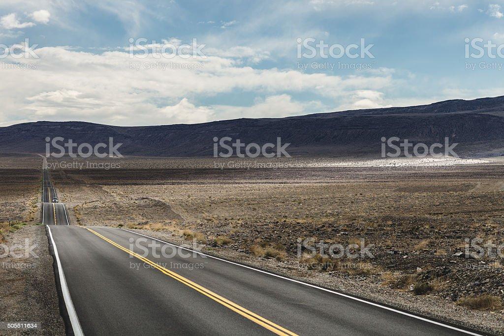 Highway through the desert region of Death Valley stock photo