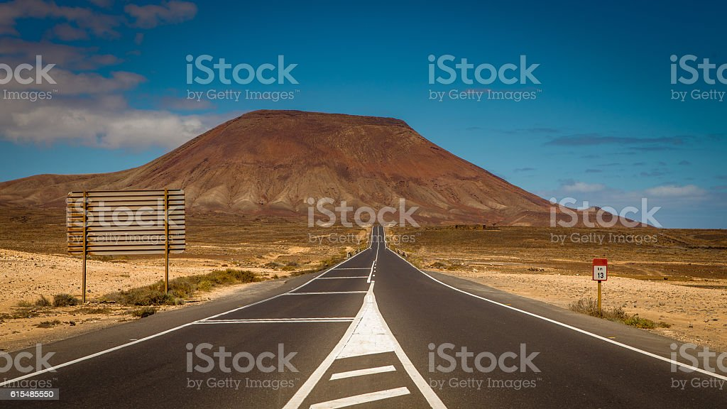 highway through volcanic landscape stock photo