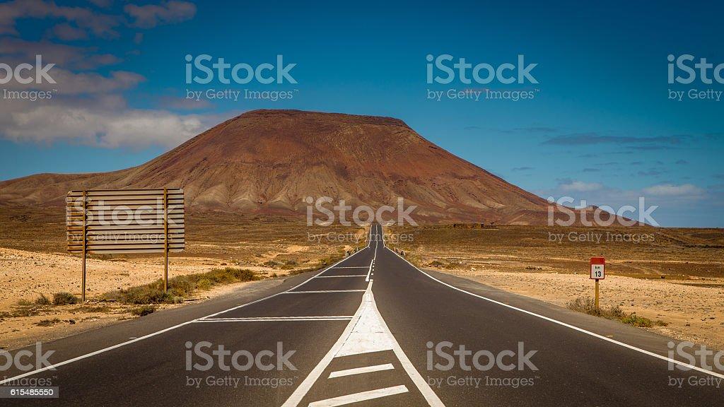 highway through volcanic landscape stock photo