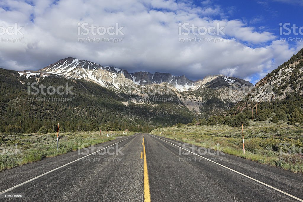 Highway to the mountains stock photo