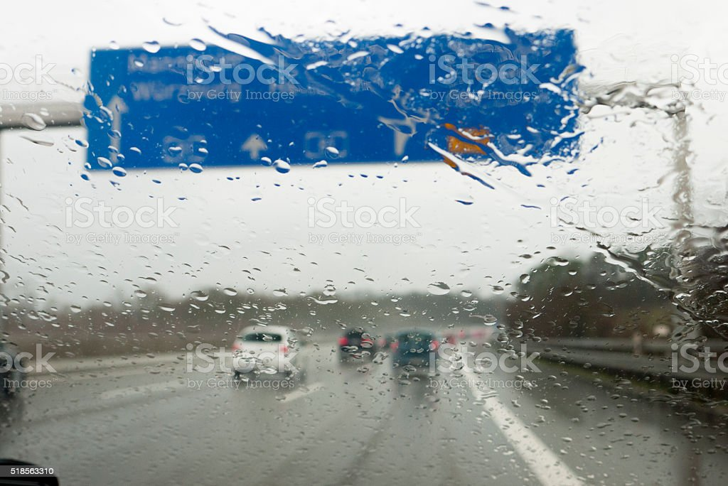 highway traffic on a rainy day stock photo