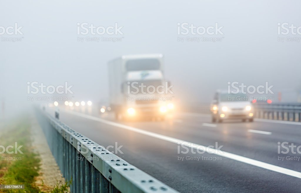 Highway Traffic with fog stock photo