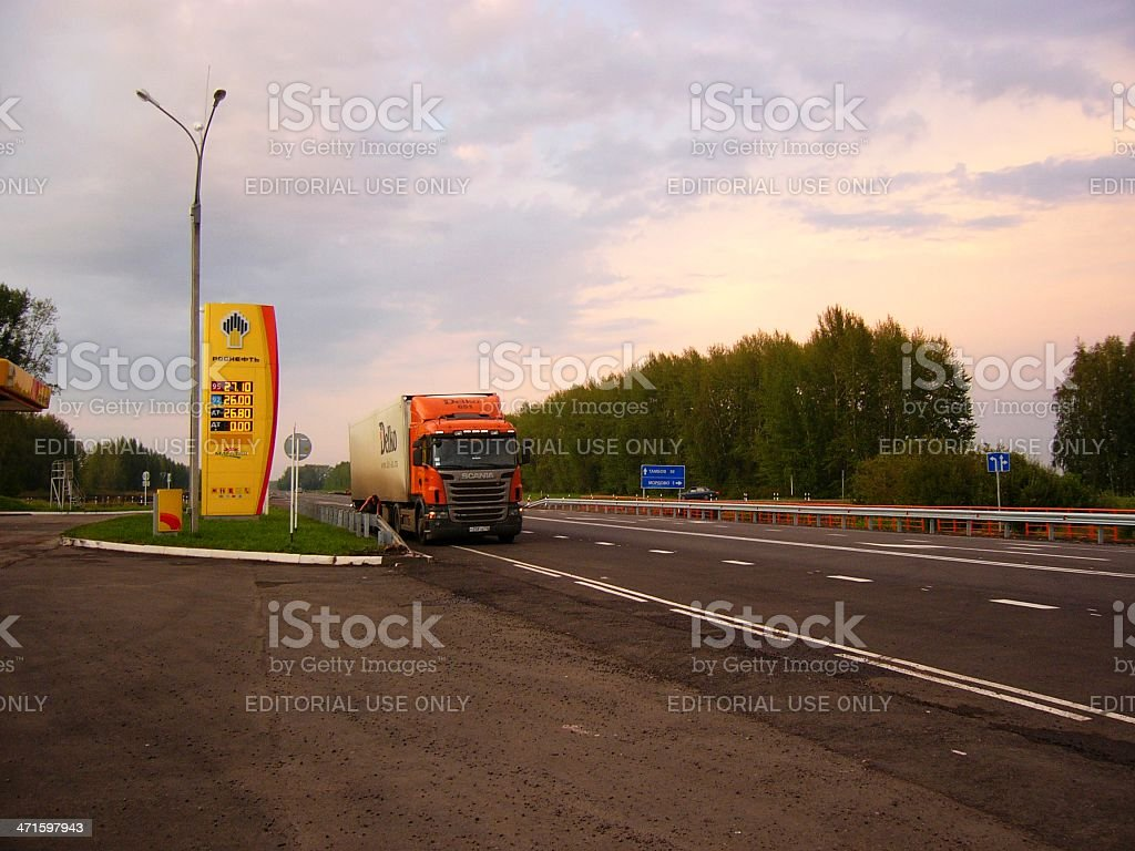 Highway, truck and gas station billboard at sunset royalty-free stock photo