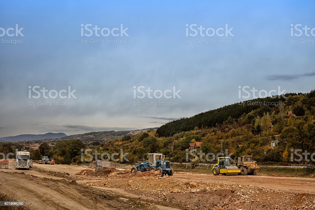 Highway under construction. Construction machines on new motorway. stock photo
