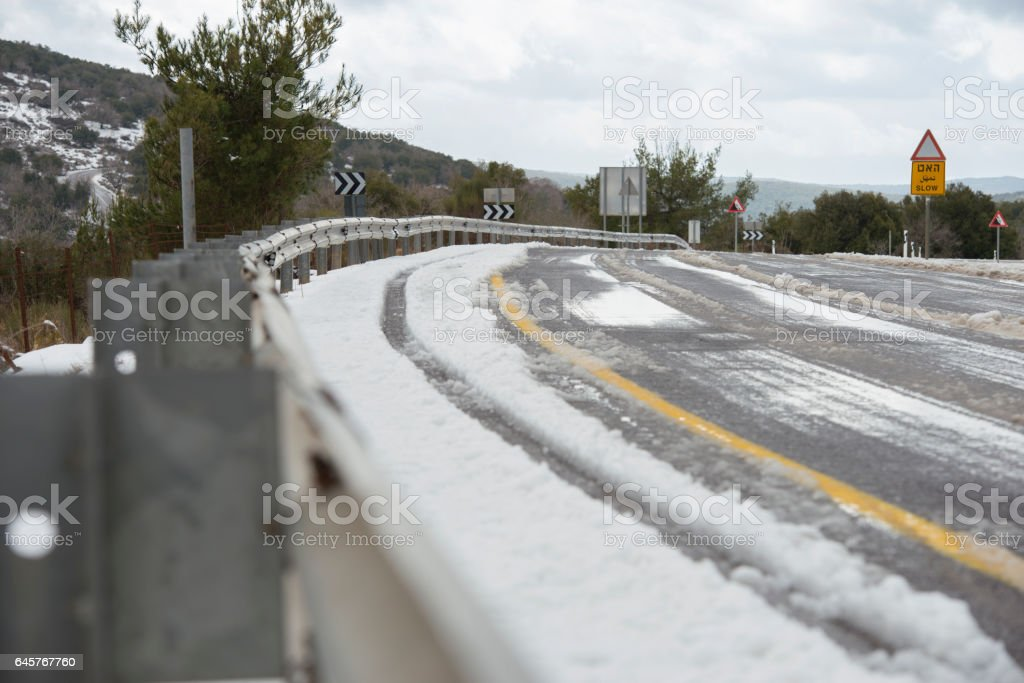 Highway under snow. Dangerous section of curved road. stock photo