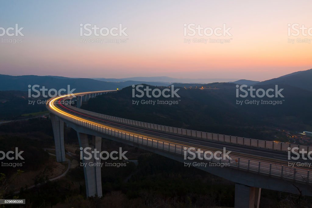 Highway viaduct at dusk stock photo