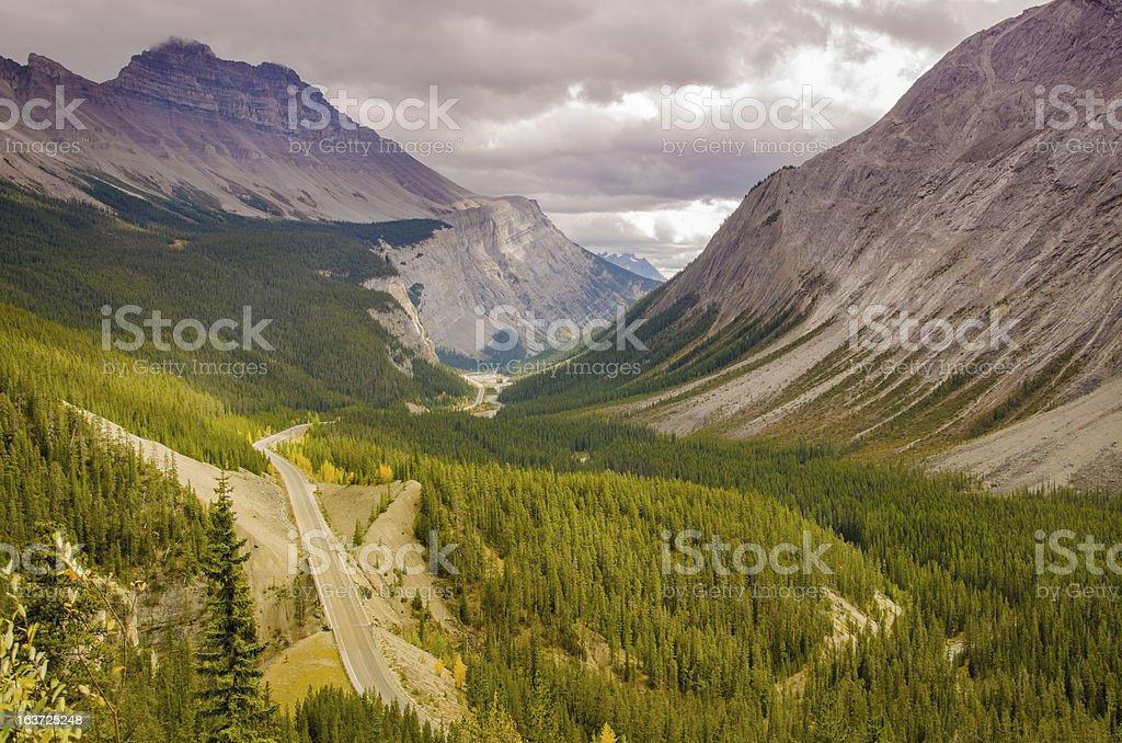 Highway weaving through Canadian Rockies royalty-free stock photo