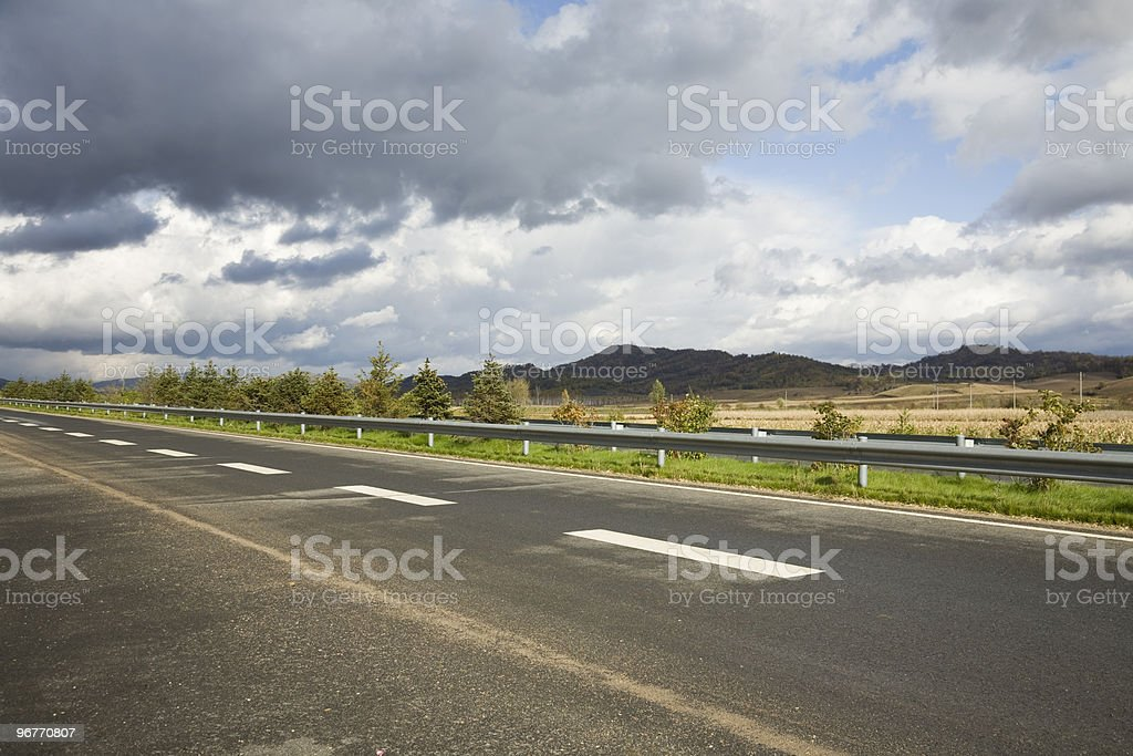 highway with a moody sky royalty-free stock photo
