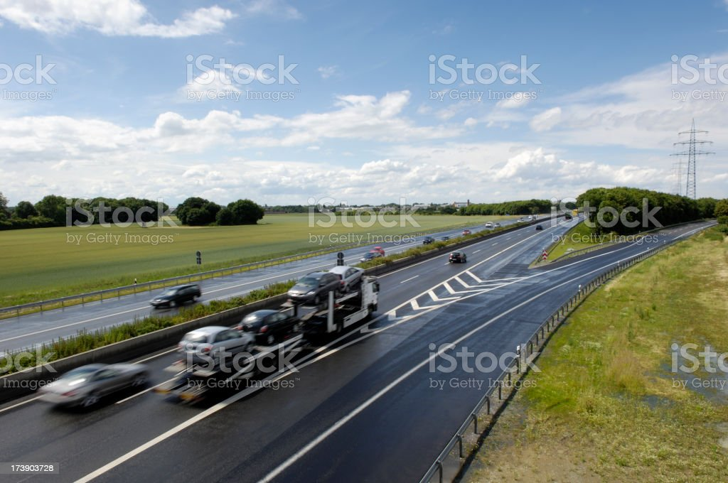 Highway with car transporter and other cars stock photo