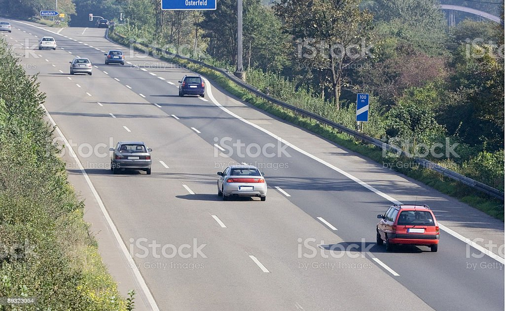 highway with cars overtaking stock photo