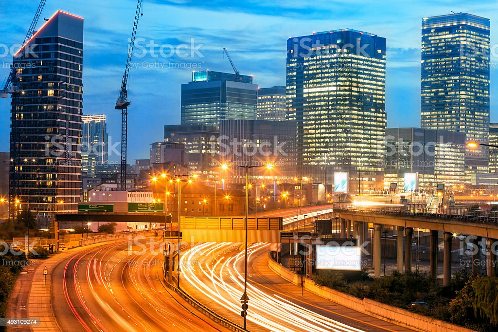 Highway with Traffic at Dusk and Canary Wharf Skyline, London stock photo