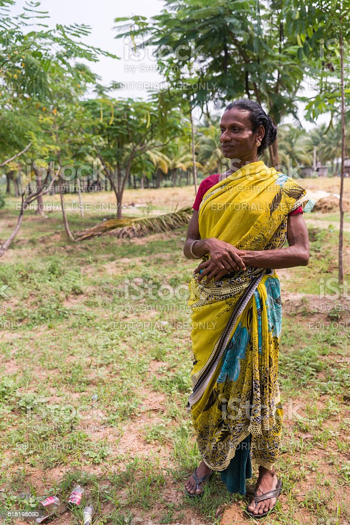 Hijra transgender person in rural setting. stock photo