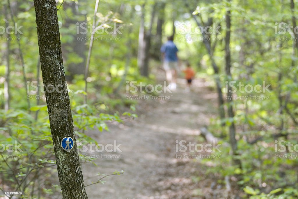 Hike With Mom & Son Passing Trail Marker Horizontal stock photo