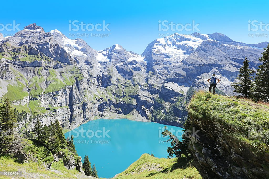 Hiker Admiring Oeschinen Lake in Switzerland stock photo