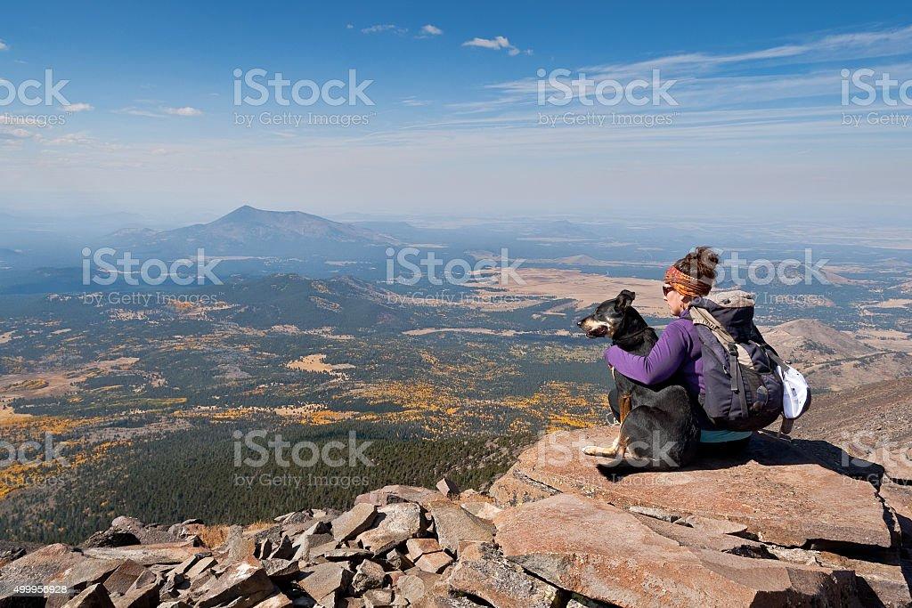 Hiker and Dog on Humphreys Peak stock photo