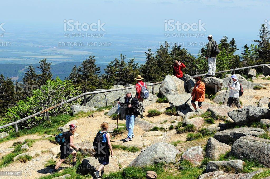Hiker arriving the peak of Brocken Mountain royalty-free stock photo