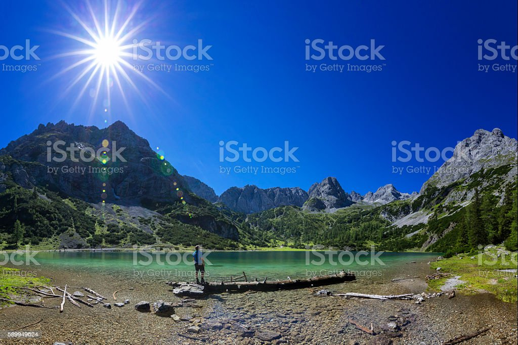 Hiker at alpin Lake at sunny day - Seebensee Tirol stock photo