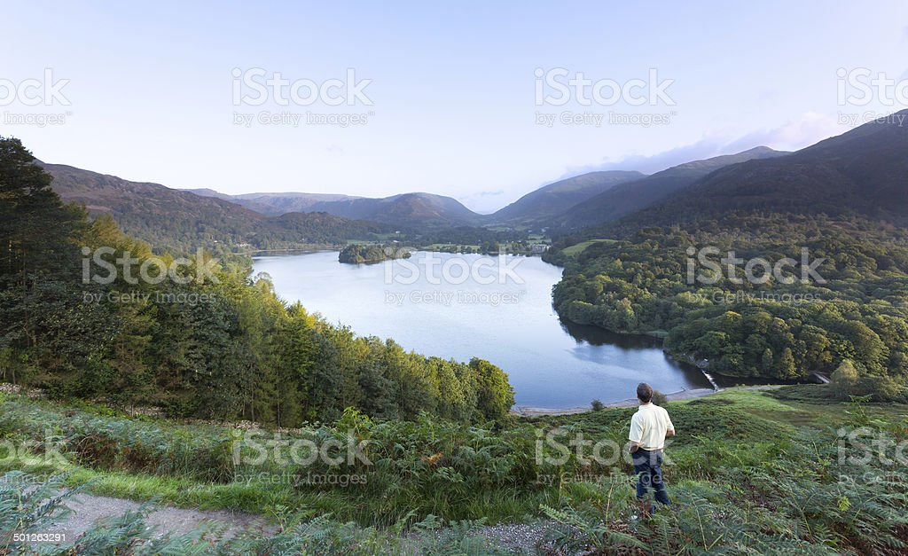 Hiker at Grasmere dawn in Lake District stock photo