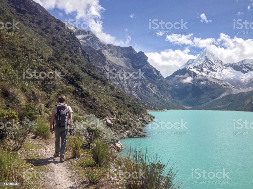 Hiker At Lake Paron In The Peruvian Andes stock photo